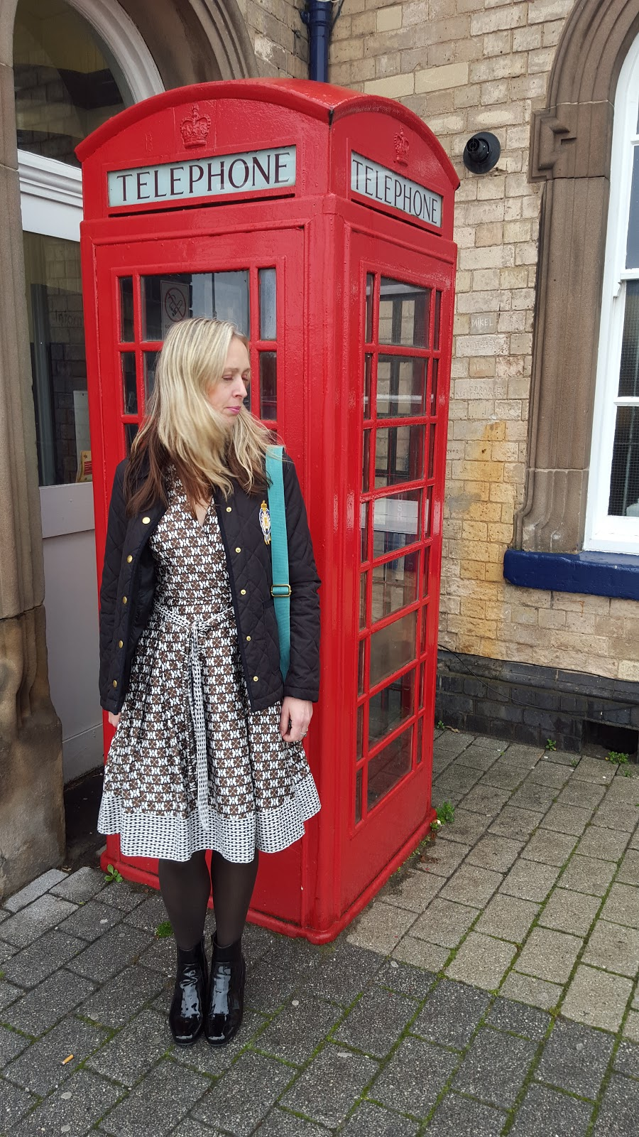 Winter Style, Patient Boots And Red Phone Box