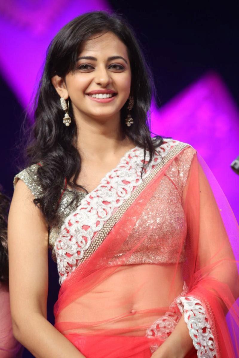 South Indian Actress Rakul  Preet Singh Navel Show Stills In Transparent Pink Saree