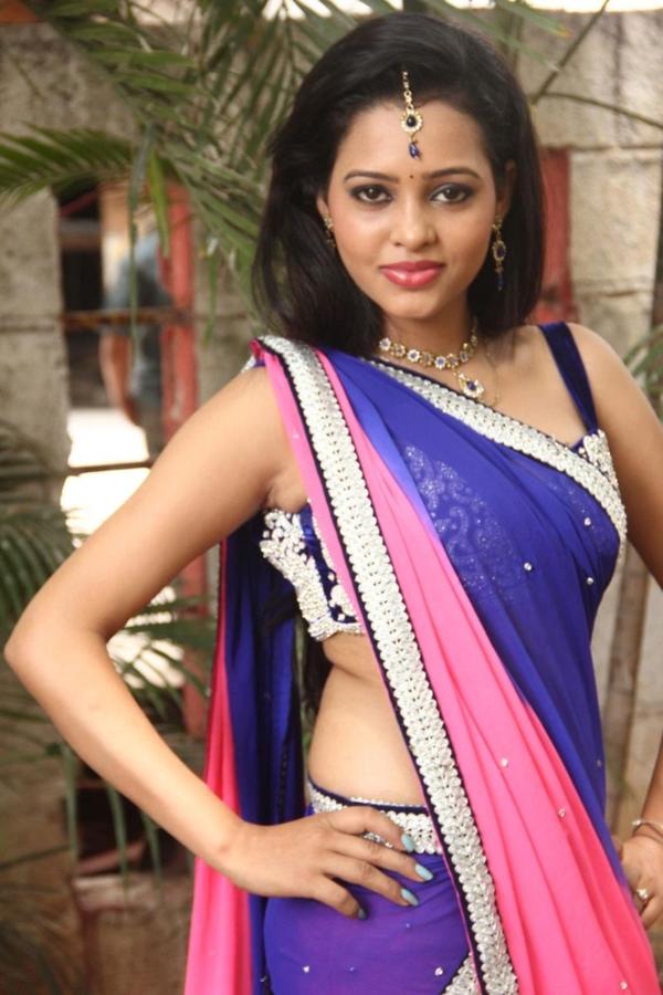 Gorgeous exotic sparkling Manitha in saree latest photos
