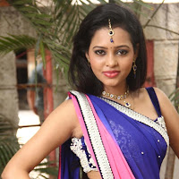 Gorgeous exotic sparkling Manitha in saree latest photos