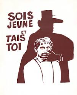 "A two-tone brown and cream illustration showing the silhouette of a man in a broad-brimmed hat standing behind a young teen boy. The boy is wearing a white collared shirt and suspenders, and the silhouette man has his hand over the boy's mouth. To the left of the two figures is text reading ""Sois Jeune et Tais Toi."""