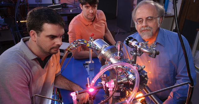 In the Astrophysics and Astrochemistry Lab at NASA's Ames Research Center researchers Michel Nuevo, Christopher Materese and Scott Sandford study the cosmic origins of molecules that are important to life. Credits: NASA/Ames Research Center/Dominic Hart