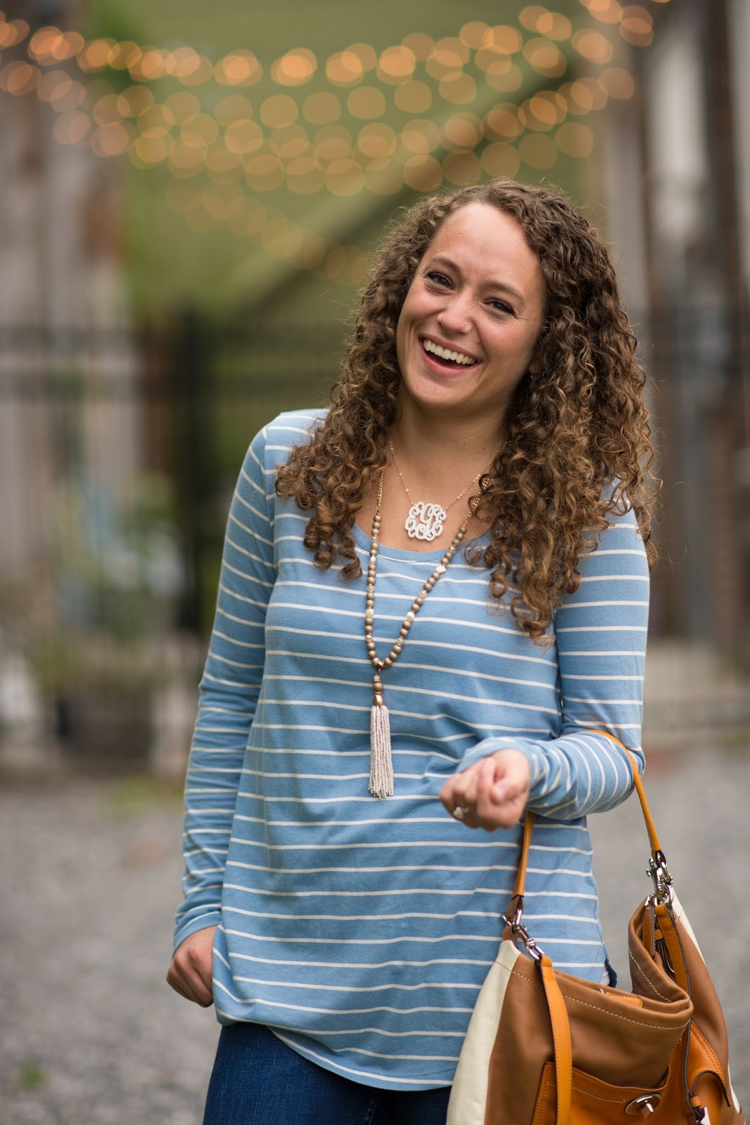 Blue and White Striped Shirt and Jeans with a Tassel Necklace