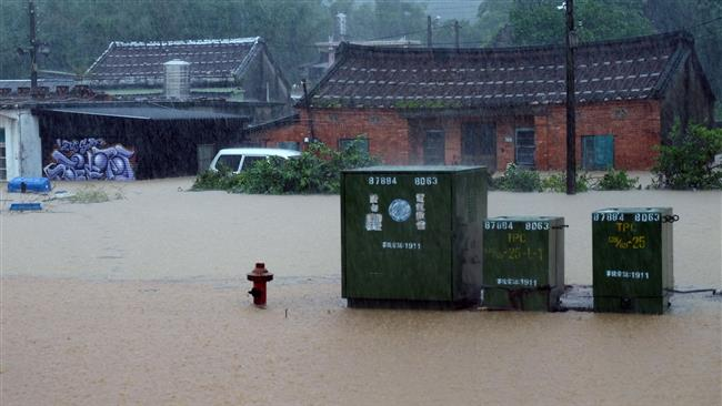 Taiwan struggles with floods after torrential rain