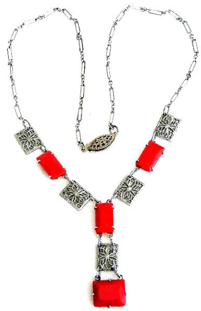 Edwardian or Art Deco necklace with lipstick-red glass stones and floral filigree is rhodium or silver plate. Circa 1920's-1930's. Via Diamonds in the Library.