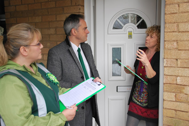 Julie on a resident's doorstep with Jonathan Bartley