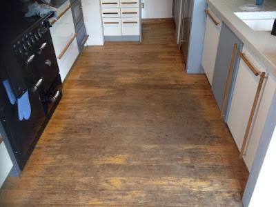 Worn floorboards in the kitchen