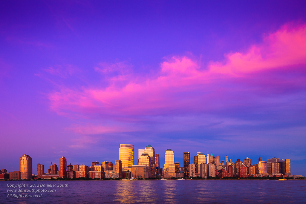 a photo of lower manhattan new york under a pink sky