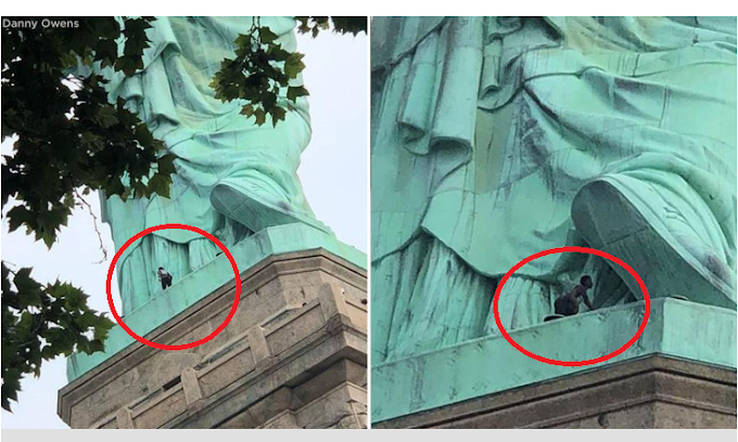 Woman spotted climbing the statue of liberty (Video)