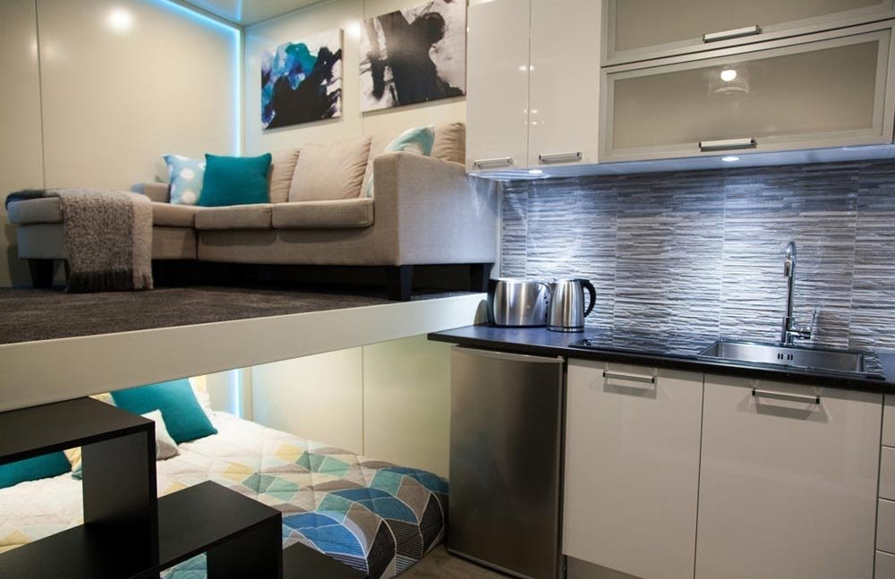 06-Kitchen-Living-Room-and-Bedroom-NZ-Tiny-House-Minimalist-and-Space-Age-Architecture-www-designstack-co