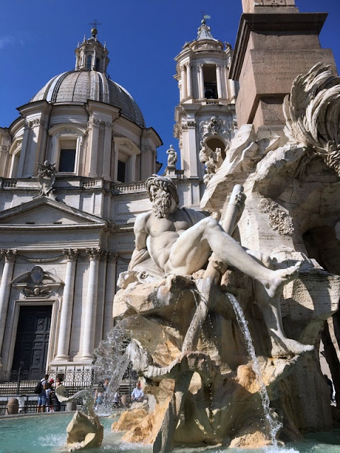 fountain and buildings in Piazza Navona in Rome, Italy