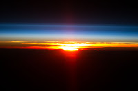 Earth's Atmosphere and Sunrise over Pacific Ocean seen from the International Space Station