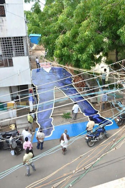 While the Kabali frenzy grips parts of the country, Rajanikanth fans at Trichy have set a new record by putting up a 65 feet poster of the super star.   It breaks the existing record of a 40-feet Rajanikanth cutout, which had been out up by the producer of Kabali, Kalaipuli Thanu.   According to fans, each feet in the cutout represents a year in the life of the 65 year old actor.