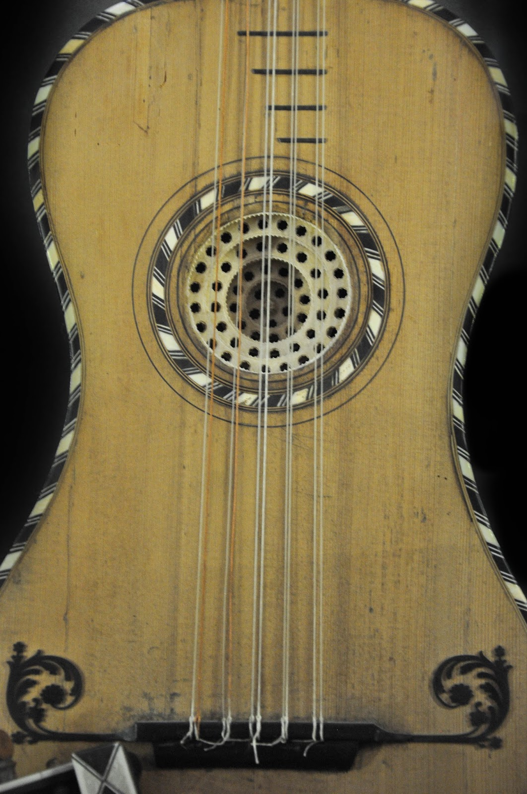 A close-up of a guitar from 1750, Museum of the Music, Venice, Italy