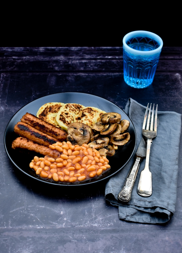 Scottish Potato Scones in a full cooked vegan breakfast with sausages, baked beans and mushrooms
