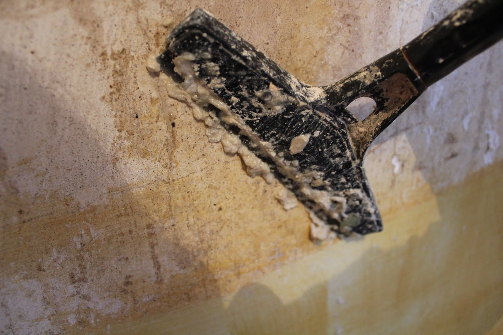 how to remove wallpaper adhesive easily