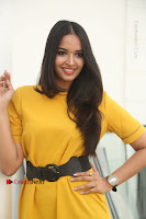 Actress Poojitha Stills in Yellow Short Dress at Darshakudu Movie Teaser Launch .COM 0150.JPG