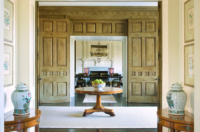 Foyer in a South Carolina estate with beautiful wood paneled doors