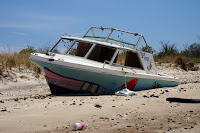 Abandoned boat on beach