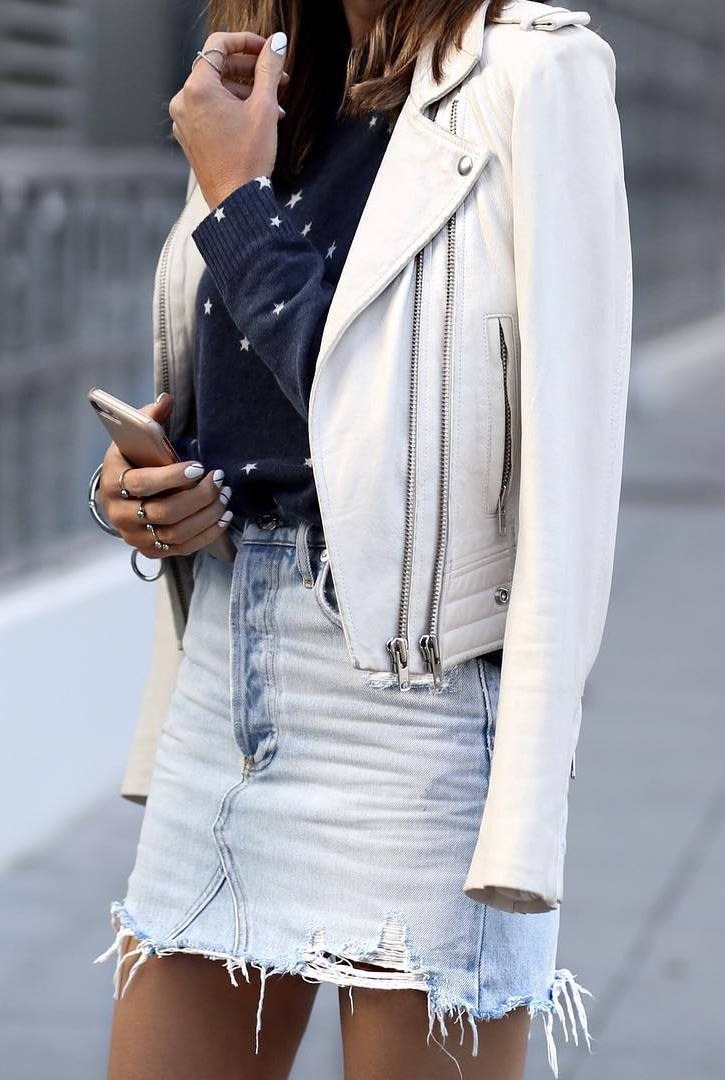 how to style a denim skirt : white biker jacket and printed sweater