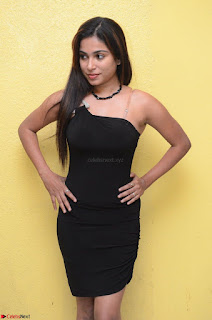 Vrushali Gosavi in strapless Short Black Dress At Follow Follow U Audio Launch 068.JPG