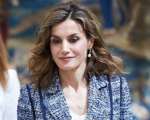 Queen Letizia delivery the Reina Letizia Awards 2015. Queen Letizia wore Hugo Boss skirt, Magrit pumps, Tous Jeweler pearl earrings