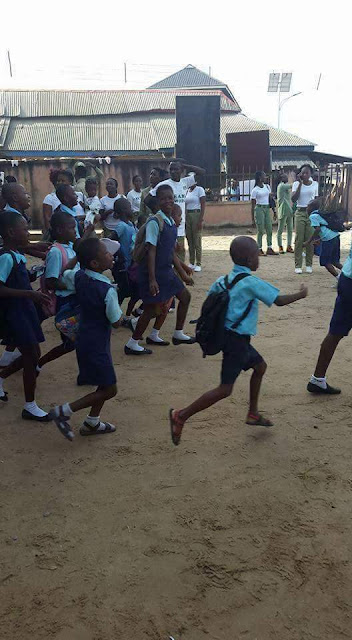 children jumping over school fence to escape forced vaccination by soldiers in Rivers State