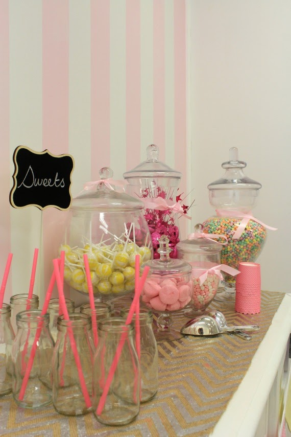 Image of lolly buffet at birthday party with pink stripe wall