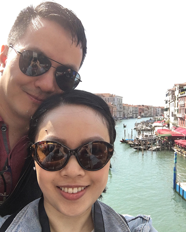 Selfie on the Rialto Bridge looking over Grand Canal, Venice, Italy