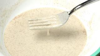 Rice flour batter running through tines of a fork.