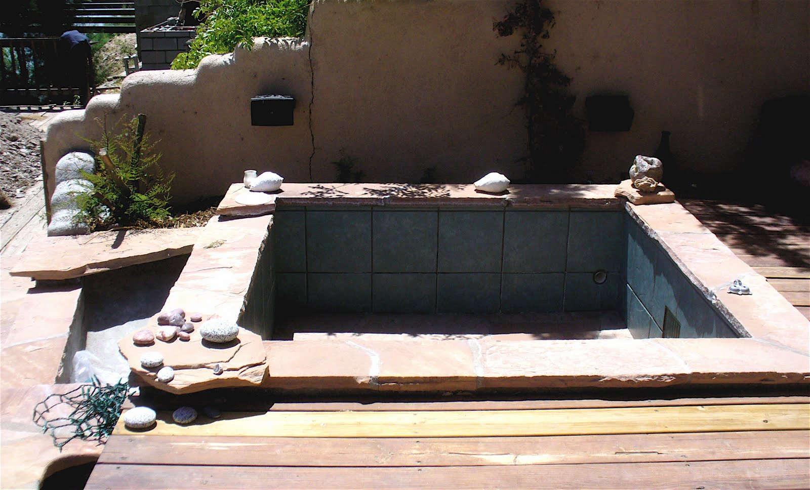 A Concrete And Tile Pool