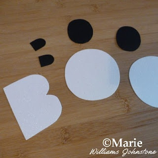 White cardstock BOO letters cut out with black inside pieces