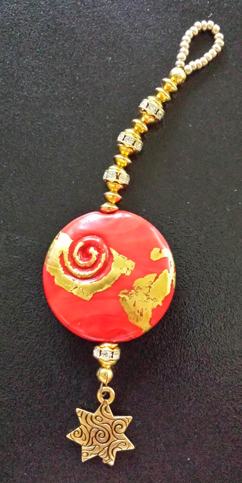 2014 Holiday Ornament Exchange, red lentil with gold leaf by Susan Kenedy of Sue Beads