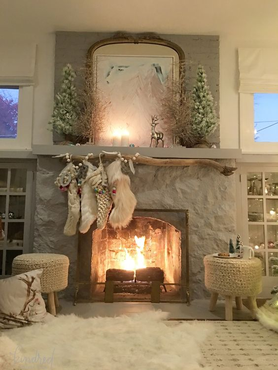 Fireplace in living room with romantic Farmhouse Christmas holiday decorating shabby chic