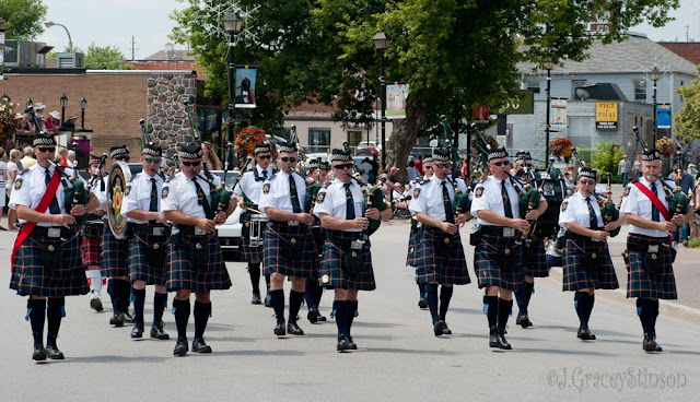 Pipe and Drum band in kilts in the Scottish Festival parade, downtown Orillia.