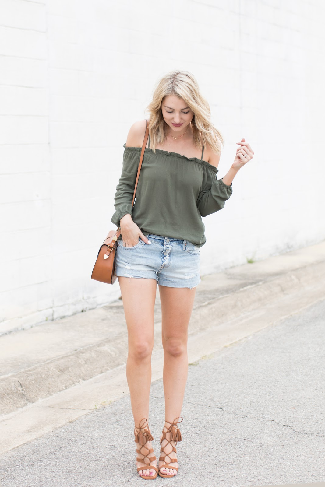 Cold shoulder top with jean shorts