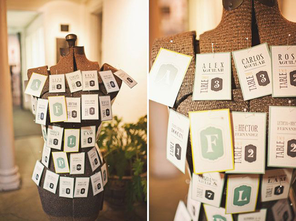Table numbers graphic design cards pinned on a dress form