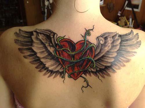 büyük kalp dövmesi kanatlı big heart tattoo with wings