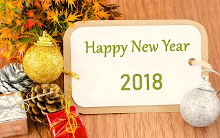 Advance-2018-new-year-wishes-picture-with-gifts-background.jpg