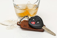 Picture of car keys next to an alcoholic beverage