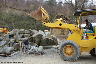 Lifting and moving stone sculpture prepare for installation Cava Nardini Vellano Tuscany Italy