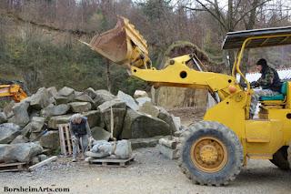 Lifting and moving stone sculpture prepare for installation Cava Nardini Vellano Tuscany Italy
