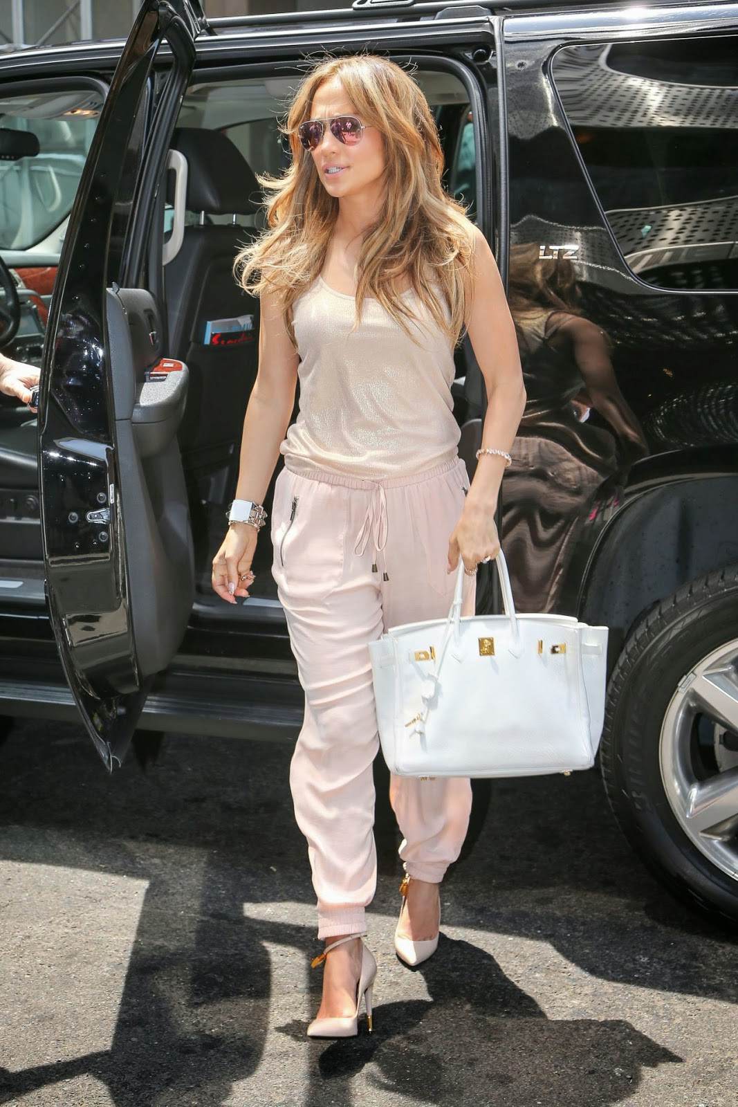 51816c0f2406 Jennifer Lopez was spotted out in NYC wearing Tom Ford python lock  pointed-toe pumps. They feature nude leather with a gold padlock  embellished wrap-around ...