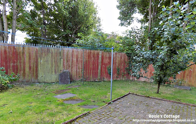 Very wide and tall fence at the back of the garden before being re-built