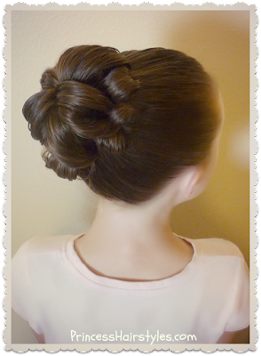 Easy and quick topsy tail bun tutorial.  Only one elastic and no bobby pins!