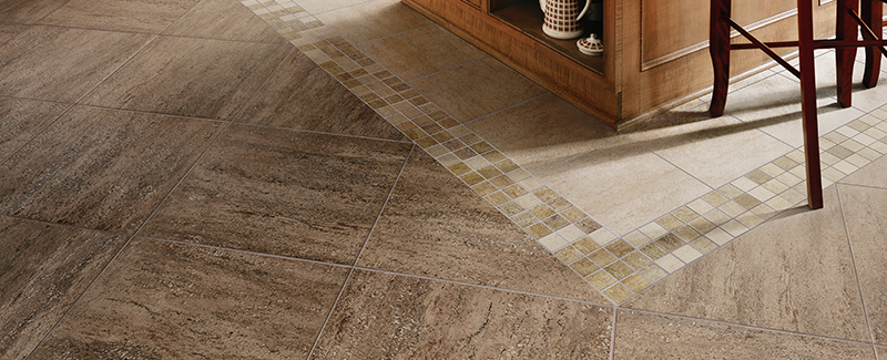 A mosaic tile border acts as a transition between two different types of tile