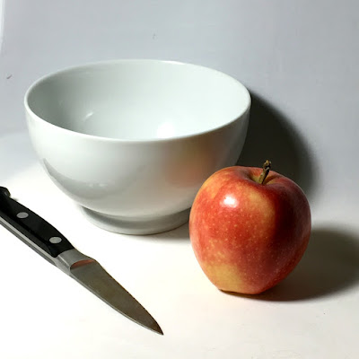 still life reference photo of knife bowl apple