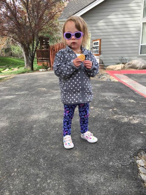 Toddler eats and walks