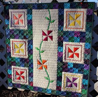 Perennial-Pinwheel-Scrap-Baby-Quilt