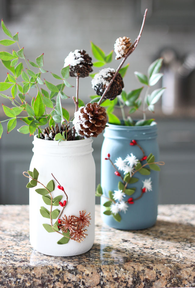 Such a pretty mason jar craft idea - winter floral vases!